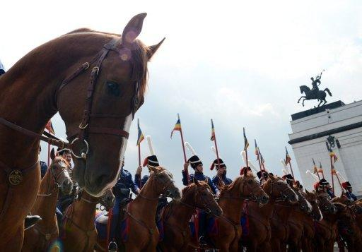 Russian cossacks wearing historic outfits ride horses during the start of their march