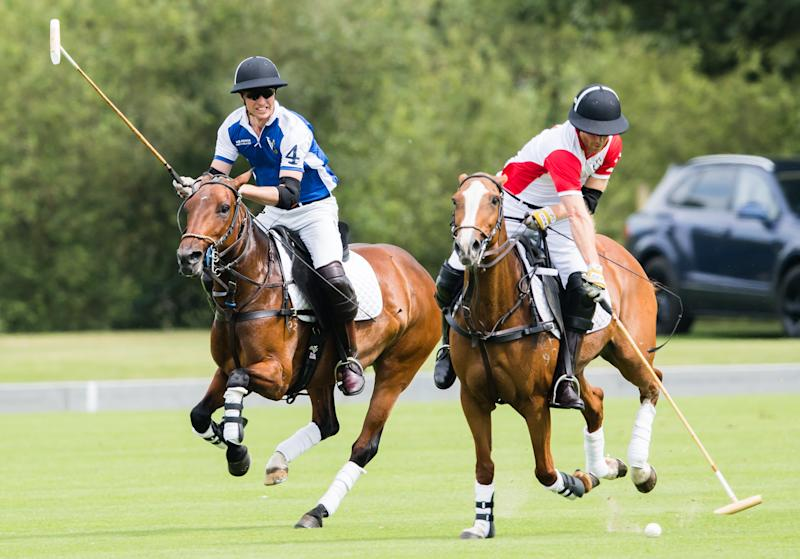 Prince William, Duke of Cambridge and Prince Harry, Duke of Sussex playing polo