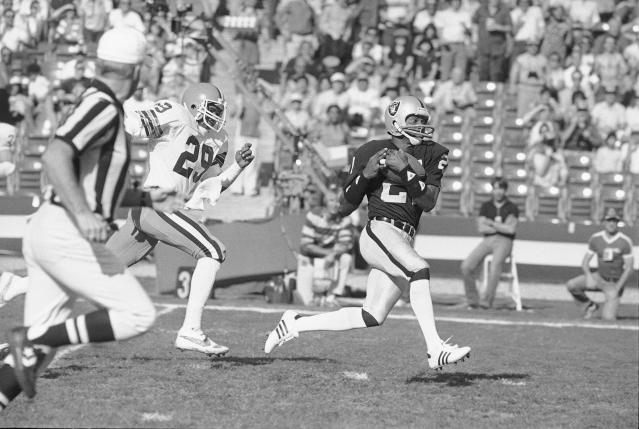 FILE - In this Jan. 8, 1983, file photo Los Angeles Raiders wide receiver Cliff Branch, right, catches a pass from quarterback Jim Plunkett for a 64-yard gain during the first quarter of a playoff game with the Cleveland Browns in Los Angeles. Branch, one of the Raiders' career-leading receivers who won three Super Bowls, has died. He was 71. (AP Photo, File)
