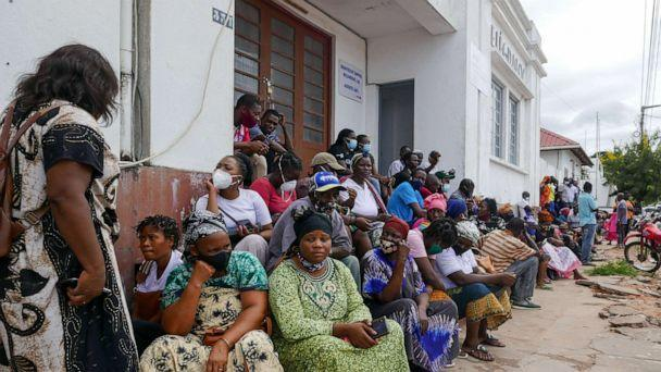 PHOTO: People await the arrival of more ships from Palma district with people fleeing attacks by rebel groups, in Pemba, Mozambique, March 29, 2021. (Luis Migel Fonseca/EPA/Shutterstock)
