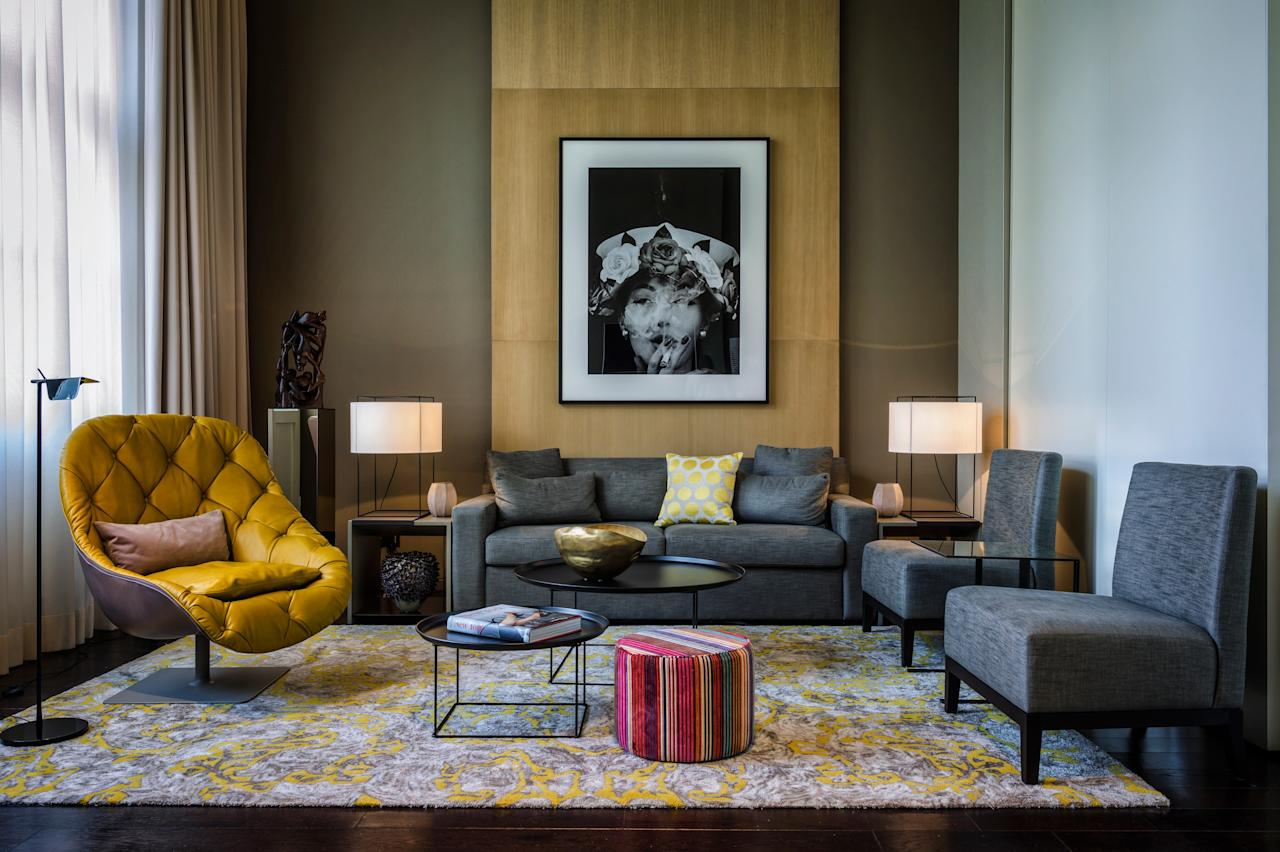 <p><strong>Set the scene: What's it like to walk into this place?</strong><br> A grand 1930s neoclassical stone building, once home to the Royal Danish Embassy, is the setting for this luxurious boutique hotel, with an enviable location next to the Berlin Zoo and Tiergarten park. The high-ceilinged lobby, with its magnificent original white marble staircase, wows upon entry; designer Patricia Urquiola has made the dramatic space cozier with comfortable modern furnishings of her own design and quirky leather animals throughout. The hotel's public spaces resemble a gallery, with mesh sculptures of monkeys by Benedetta Mori, an enormous crocodile head from Quentin Garel, and photos by celebrated shutterbugs including Diane Arbus and Helmut Newton gracing the walls.</p> <p><strong>Who stays here?</strong><br> As you might expect at a five-star design property, the fashionable will feel right at home here.</p> <p><strong>We've checked in, we've made it to our room. What can we expect?</strong><br> The 78 rooms, 20 of them suites, are spread throughout the landmark building and a newer annex. There are seven different categories, and each is slightly different in layout, but all are remarkably spacious, even the entry-level SO Stue room. Patricia Urquiola worked her magic with the interiors, resulting in a fusion of high-end modern and classic furnishings, rich fabrics, and warm woods. Some rooms feature lofty ceilings and huge windows with views of the zoo and Tiergarten; 11 have balconies or terraces. Bathrooms have rain showers and/or freestanding bathtubs, plus Diptyque toiletries.</p> <p><strong>Anything of note among the amenities?</strong><br> The higher-end suites include copious freebies, such as complimentary laundry service, a free mini-bar, and free limousine transfers to and from the airport. All rooms have Nespresso machines and mini-bars.</p> <p><strong>If we're looking for a meal, or a drink, where should we go?</strong><br> Experiment with molecular gastr