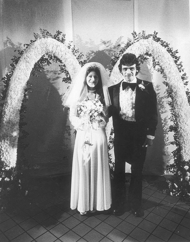 <p>This happy couple made the unique decision to tie the knot at McDonald's, floral arches and all.</p>