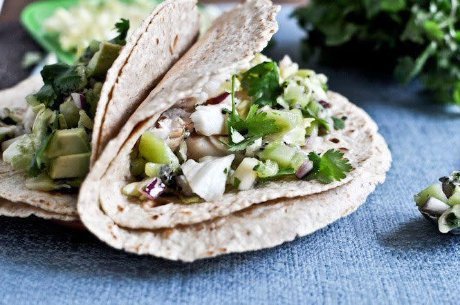 "<strong>Get the recipe for <a href=""http://www.howsweeteats.com/2012/02/grilled-coconut-lime-tilapia-tacos-with-kiwi-salsa/"" rel=""nofollow noopener"" target=""_blank"" data-ylk=""slk:grilled coconut lime tilapia tacos with kiwi salsa"" class=""link rapid-noclick-resp"">grilled coconut lime tilapia tacos with kiwi salsa</a> by How Sweet Eats.</strong>"