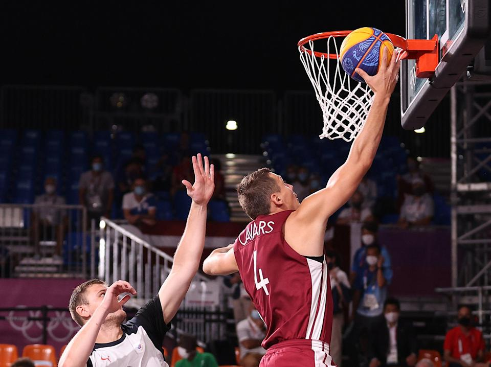 Agnis Cavars looks to score for Latvia in the men's 3x3 final (Getty)