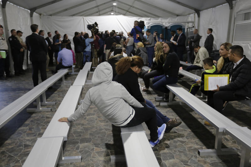 Migrants who are applying for asylum in the United States wait in a holding area at a new tent courtroom at the Migration Protection Protocols Immigration Hearing Facility, Tuesday, Sept. 17, 2019, in Laredo, Texas. (AP Photo/Eric Gay)