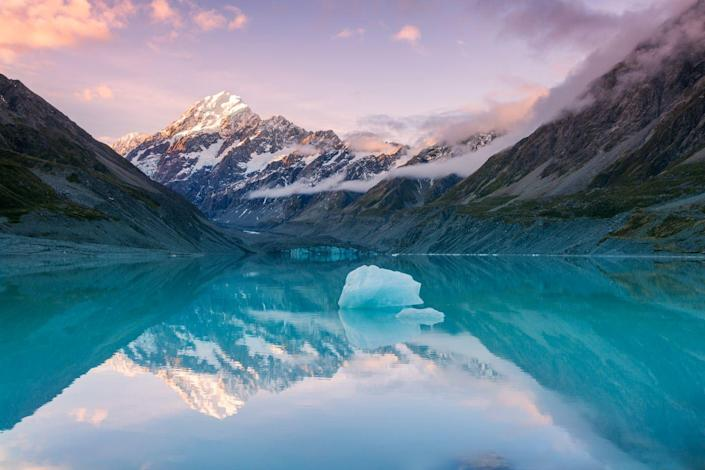 <p>A small iceberg sits in the middle of a lake in Aoraki Mount Cook National park near Canterbury, New Zealand.</p>