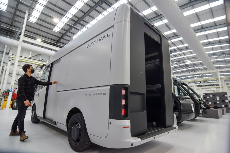 A man looks at a fully-electric test van, due to go into production in 2022, in Banbury