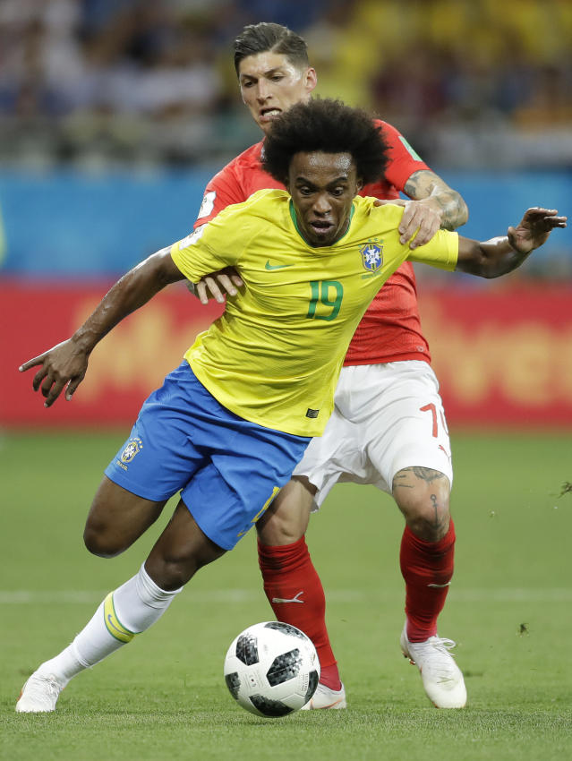 Brazil's Willian, left, and Switzerland's Steven Zuber challenge for the ball during the group E match between Brazil and Switzerland at the 2018 soccer World Cup in the Rostov Arena in Rostov-on-Don, Russia, Sunday, June 17, 2018. (AP Photo/Felipe Dana)