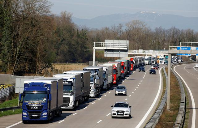 Trucks parked on the German motorway near the German-Swiss border after Germany announced border controls, as the country faces an aggressive progression of the coronavirus disease. Weil am Rhein, Germany, March 16, 2020. Photo:Arnd Wiegmann/Reuters