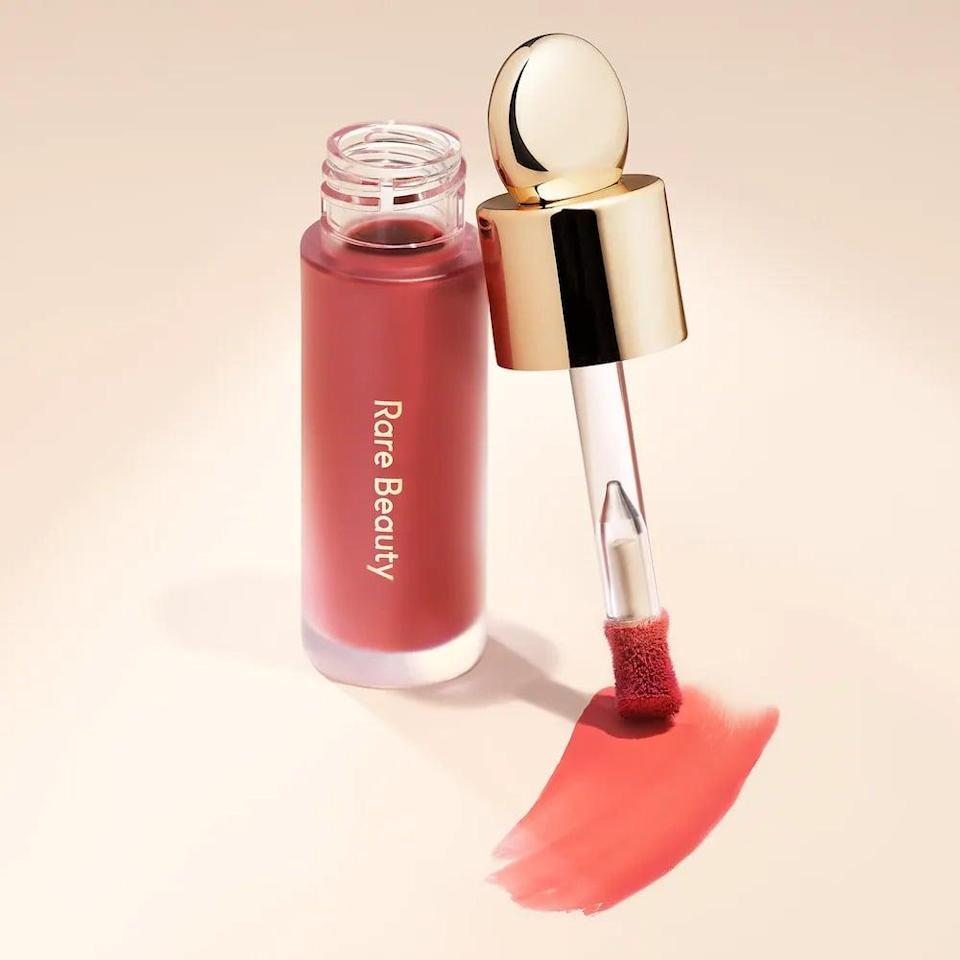 <p>A few dots of the <span>Rare Beauty Soft Pinch Liquid Blush</span> ($20) on your cheeks will give you that flirty flush of color for the summer.</p>