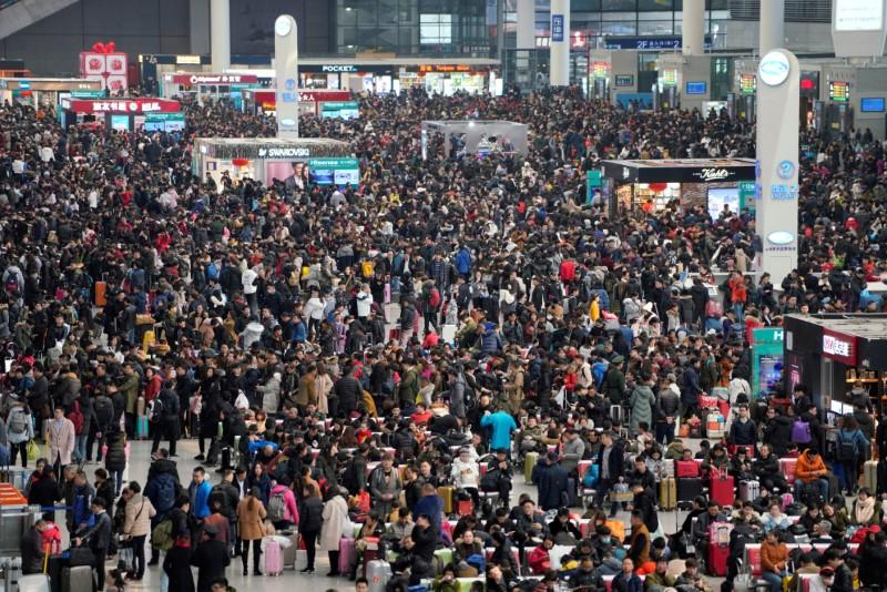 FILE PHOTO: File picture of passengers waiting to board trains at Shanghai's Hongqiao Railway Station as the annual Spring Festival travel rush begins ahead of the Chinese Lunar New Year in Shanghai