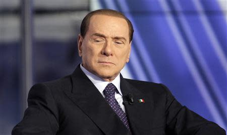 Italy's former Prime Minister Silvio Berlusconi appears as a guest on the RAI television show Porta a Porta (Door to Door) in Rome