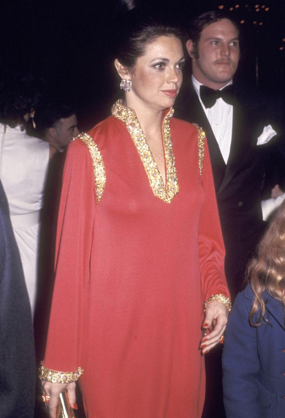 <p>This red gown with gold trimmings and a statement neck was one to remember from the 1972 Golden Globes. </p>