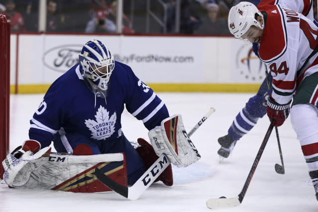 Toronto Maple Leafs goaltender Michael Hutchinson (30) defends a shot by New Jersey Devils left wing Miles Wood (44) during the second period of an NHL hockey game Thursday, Jan. 10, 2019, in Newark, N.J. (AP Photo/Adam Hunger)
