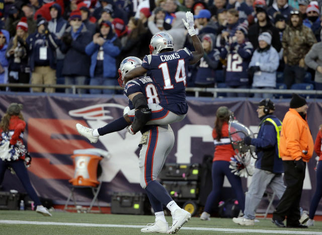 Giddyup: Patriots receiver Brandin Cooks jumped on Rob Gronkowski's back to celebrate a fourth-quarter touchdown in New England's win. (AP)