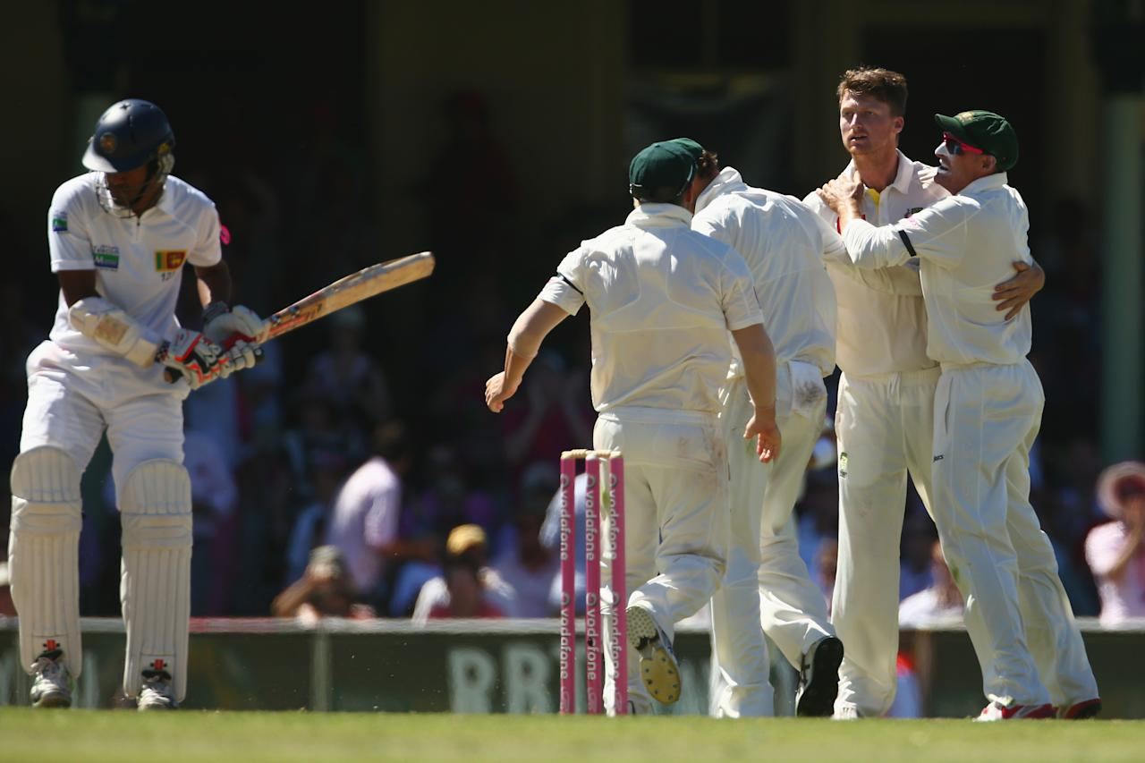 SYDNEY, AUSTRALIA - JANUARY 05:  Jackson Bird of Australia celebrates with his team mates after taking the wicket of Dimuth Karunaratne of Sri Lanka during day three of the Third Test match between Australia and Sri Lanka at Sydney Cricket Ground on January 5, 2013 in Sydney, Australia.  (Photo by Mark Kolbe/Getty Images)