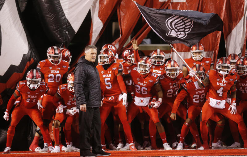 Utah head coach Kyle Whittingham and his team prepares to take the field prior to their game against the BYU during an NCAA college football game Saturday Nov. 24, 2018, in Salt Lake City. (AP Photo/Rick Bowmer)