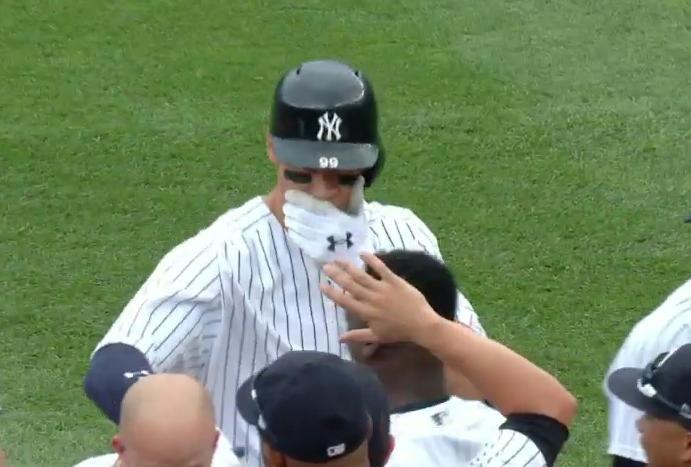 Aaron Judge protected his teeth at all cost during the Yankees walk-off celebration on Saturday. (MLB.TV)