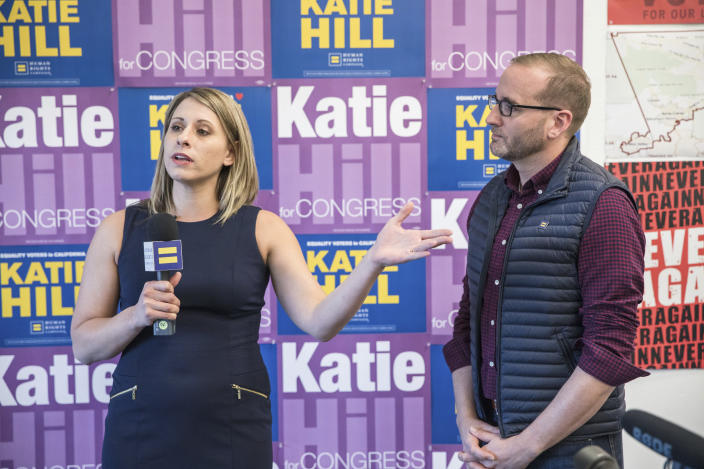 """<span class=""""s1"""">Katie Hill, who's running for Congress in California's 25th District, and Human Rights Campaign president Chad Griffin at their phone banking headquarters in Stevenson Ranch, Calif., on Oct. 18. (Photo: Matt Harbicht/AP Images for Human Rights Campaign)</span>"""