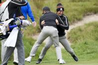 Team Europe's Viktor Hovland and Team Europe's Paul Casey have some fun on the ninth hole during a practice day at the Ryder Cup at the Whistling Straits Golf Course Thursday, Sept. 23, 2021, in Sheboygan, Wis. (AP Photo/Ashley Landis)