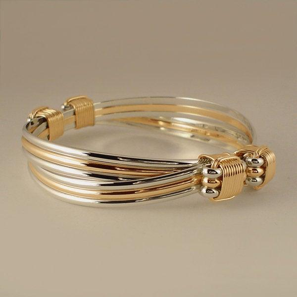 Elephant hair bracelet custom handmade with Sterling silver and Yellow Gold Filled wire in a 4 knot 6 mixed strand style Safari Bracelet™
