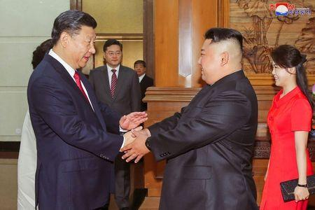Chinese President Xi Jinping shakes hands with North Korean leader Kim Jong Un in Beijing, China, in this undated photo released June 20, 2018 by North Korea's Korean Central News Agency. KCNA via REUTERS