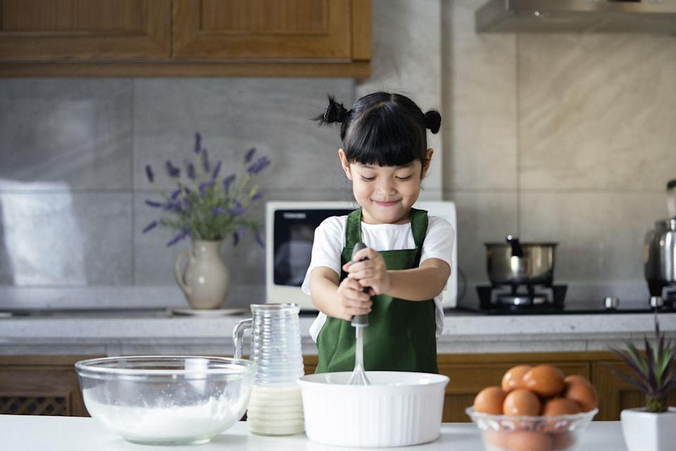 """<p>Cook up some summer fun with free recipes and activities from <a href=""""https://www.raddishkids.com/"""" rel=""""nofollow noopener"""" target=""""_blank"""" data-ylk=""""slk:Raddish"""" class=""""link rapid-noclick-resp"""">Raddish</a>, a monthly subscription kit and cooking club for kids. Kids will learn key skills in their at-home cooking camp, like cracking eggs and kneading dough. This year, the company is also offering virtual summer cooking camp (at a cost), with themes like Restaurant Camp, Around the World, and Summer Fun. The week-long camps are suitable for kids ages 8-13. """"Our cooking camps are designed to excite kids about the joys of cooking and help them hone a lifelong skill,"""" says Samantha Barnes, founder of Raddish Kids. """"From empowering kids to start and run their own restaurant to taking them on a tour of the world through flavors, our goal remains the same: to nurture kids' confidence in the kitchen and beyond."""" The company also offers a popular kids subscription kit, designed for kids ages 4-14. Each monthly kit features a different theme ranging from seasons and holidays to cultures and creative cookery.<br></p><p><a href=""""https://baketivity.com/"""" rel=""""nofollow noopener"""" target=""""_blank"""" data-ylk=""""slk:Baketivity"""" class=""""link rapid-noclick-resp"""">Baketivity</a>, a subscription-based baking box service, launched Bake-A-Camp. Campers will get a big baking box featuring four themed Baketivity kits with pre-measured ingredients, step by step instructions, and an activity book (all you need are the eggs, oil, and water). Each week's kit will take campers through progressively advanced recipes and techniques as they explore one theme, or cuisine throughout the month.</p><p>If you're looking for less of a commitment to cooking, but still want to get your kids in the kitchen, plan your own in-house cooking workshop. """"Apart from learning to make yummy dishes, children also develop mathematical skills, safety measures, cleanliness, motor skills and more,"""" says Will Ward, CEO of Ass"""