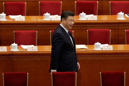 Chinese President Xi Jinping arrives for the third plenary session of the National People's Congress (NPC), where delegates will vote on a constitutional amendment lifting presidential term limits, at the Great Hall of the People in Beijing