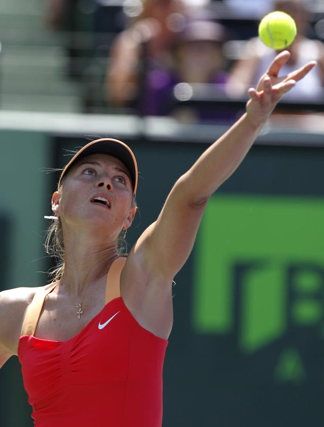 Maria Sharapova, of Russia, serves to Caroline Wozniacki, of Denmark, during the Sony Ericsson tennis tournament, Thursday, March 29, 2012, in Key Biscayne, Fla. (AP Photo/Lynne Sladky)