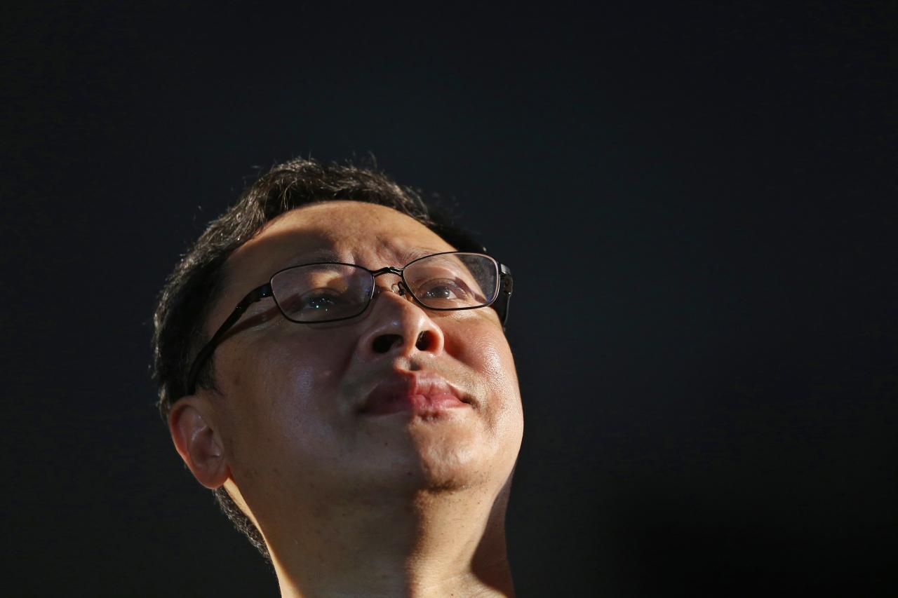 "Founder of the Occupy Central civil disobedience movement, academic Benny Tai, looks up during campaign to kick off the movement in front of the financial Central district in Hong Kong August 31, 2014. China's parliament said on Sunday it will tightly control the nomination of candidates for a landmark election in Hong Kong in 2017. Thousands of ""Occupy Central"" activists, who are demanding Beijing allow a real, free election, are threatening to blockade the city's business district in retaliation as part of a campaign of civil disobedience. REUTERS/Bobby Yip (CHINA - Tags: POLITICS CIVIL UNREST)"