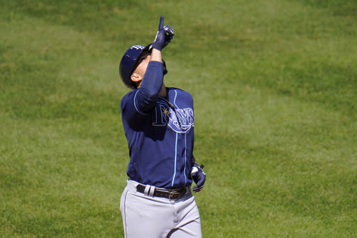 Tampa Bay Rays' Willy Adames gestures as he runs the bases after hitting a solo home run off Baltimore Orioles starting pitcher John Means during the fourth inning of a baseball game, Sunday, Sept. 20, 2020, in Baltimore. (AP Photo/Julio Cortez)