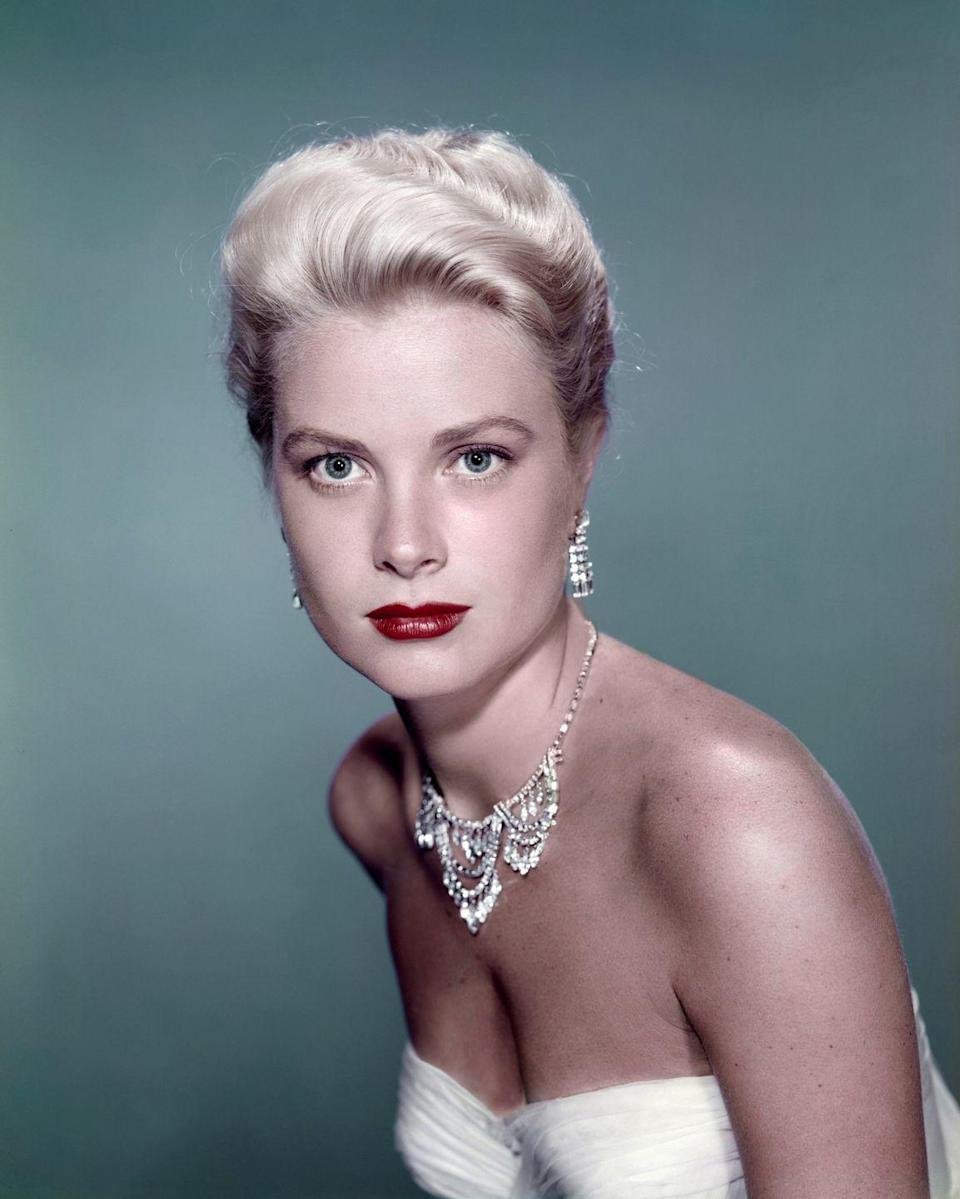 <p>Grace Kelly looked elegant in a tiered diamond necklace and fringe diamond earrings while in wardrobe from the 1955 classic, <em>To Catch a Thief</em>. Audiences expected nothing less from the Hollywood starlet. </p>