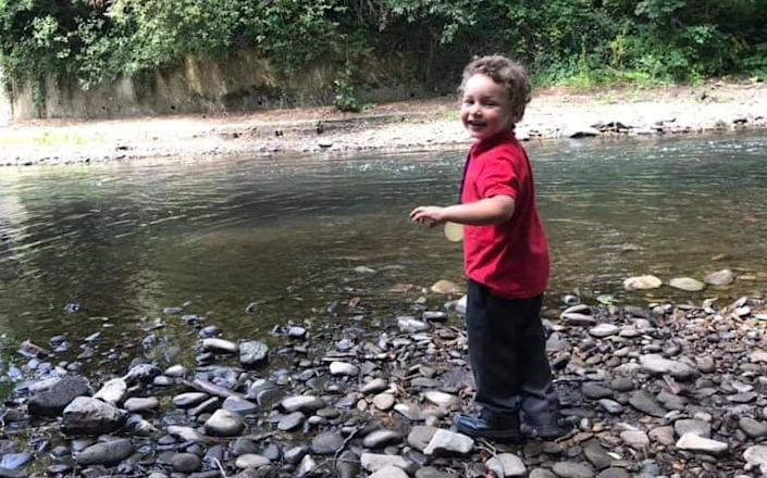Logan Williamson pictured near a river in his school uniform - Wales News