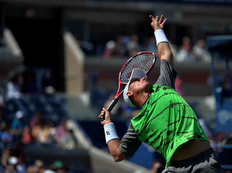 Lleyton Hewitt of Australia serves to Tomas Berdych of the Czech Republic during their 2014 US Open men's singles match on August 27, 2014 in New York