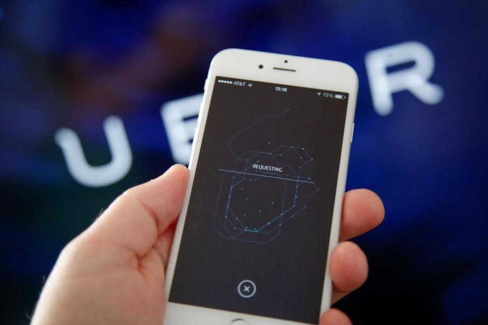 The Uber ride sharing application is seen running on an iPhone in this photo illustration taken on 28 August, 2017. (Photo by Jaap Arriens/NurPhoto via Getty Images)