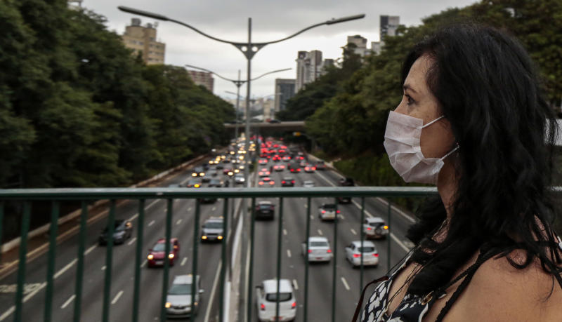 SAO PAULO, BRAZIL - MARCH 17: A woman wearing a face mask as a measurement against the spread of COVID-19 walks on the street on March 17, 2020 in Sao Paulo, Brazil. Earlier today, Brazil Health minister Luiz Henrique Mandetta confirmed a first decease related to COVID-19; there are 291positive cases in the country. (Photo by Miguel Schincariol/Getty Images)