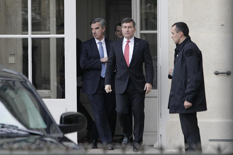 U.S Ambassador to France Charles H. Rivkin, right, leaves the Foreign Ministry in Paris, after he was summoned Monday, Oct. 21, 2013. The French government had summoned the ambassador to explain why the Americans spied on one of their closest allies. Le Monde newspaper said Monday, Oct. 21, 2013 that documents leaked by Edward Snowden show that the U.S. National Security Agency swept up 70.3 million French phone records in a 30-day period. (AP Photo/Thibault Camus)