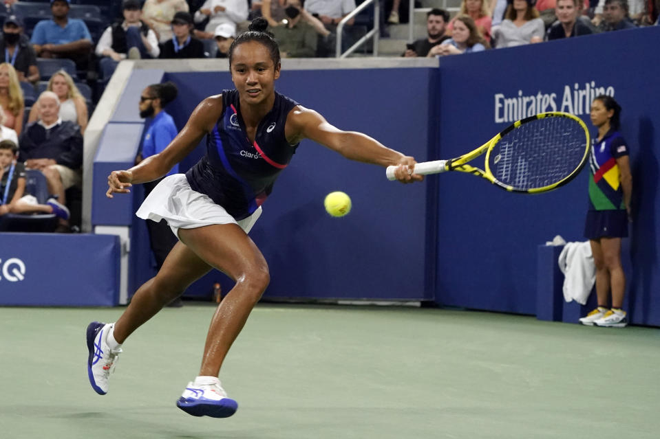 Leylah Fernandez, of Canada, returns to Angelique Kerber, of Germany, during the fourth round of the US Open tennis championships, Sunday, Sept. 5, 2021, in New York. (AP Photo/John Minchillo)