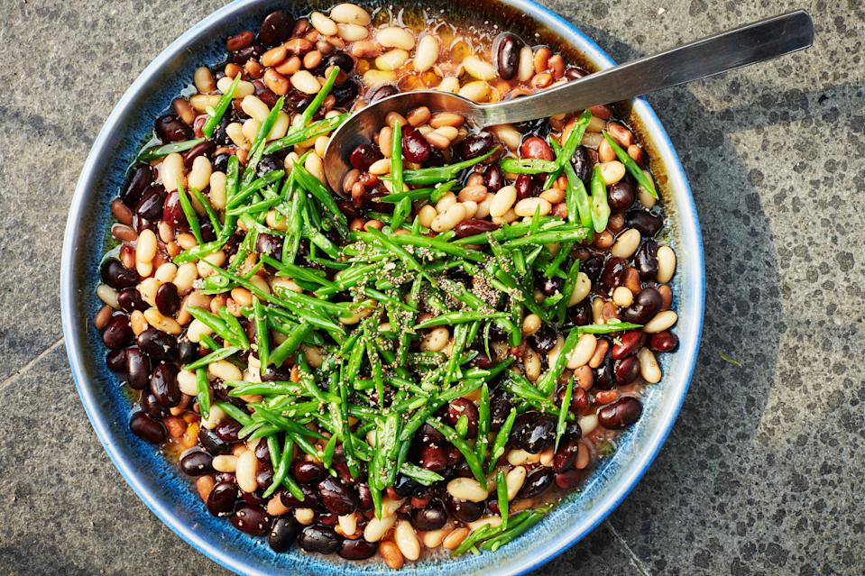 "All types of beans come in and out of season during the summer and into fall; make this with any color snap beans and your choice of fresh or canned shelling beans. Chia seeds will bloom and thicken dressing slightly. <a href=""https://www.bonappetit.com/recipe/mixed-bean-salad-tomato-vinaigrette?mbid=synd_yahoo_rss"" rel=""nofollow noopener"" target=""_blank"" data-ylk=""slk:See recipe."" class=""link rapid-noclick-resp"">See recipe.</a>"