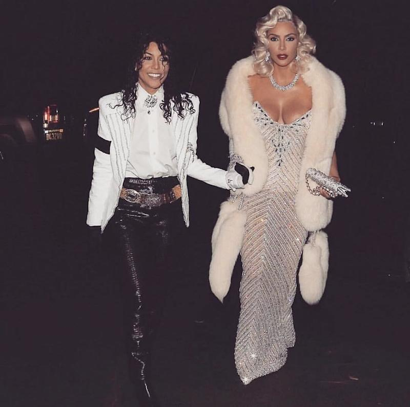 Kourtney Kardashian and Kim Kardashian dressed as Michael Jackson and Madonna at the 1991 Academy Awards for Halloween on October 31, 2017. Photo courtesy of Getty images.