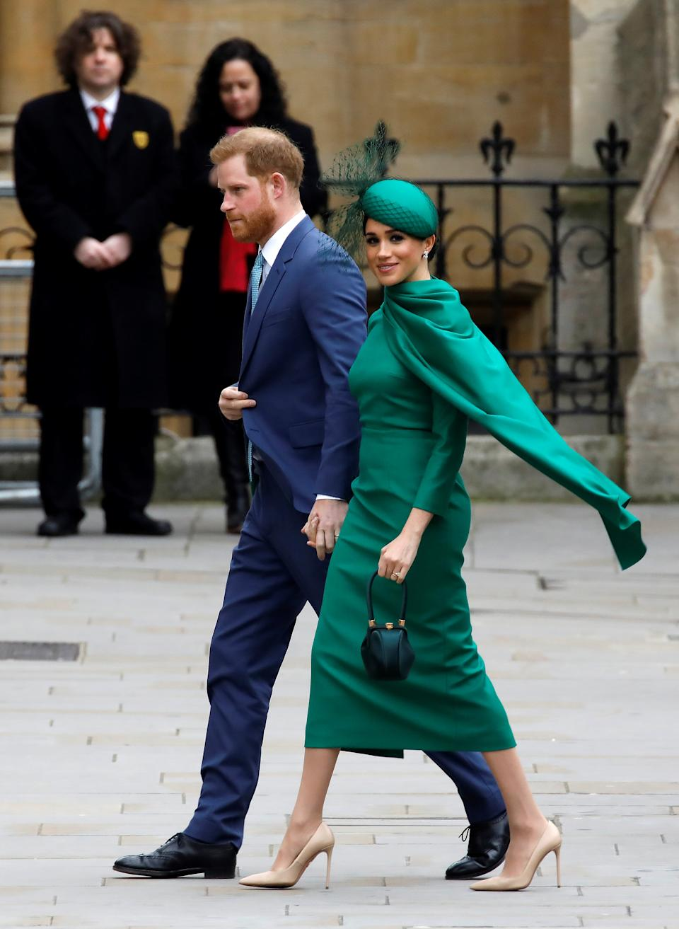Meghan wore a caped emerald gown by British designer Emilia Wickstead. (Getty Images)