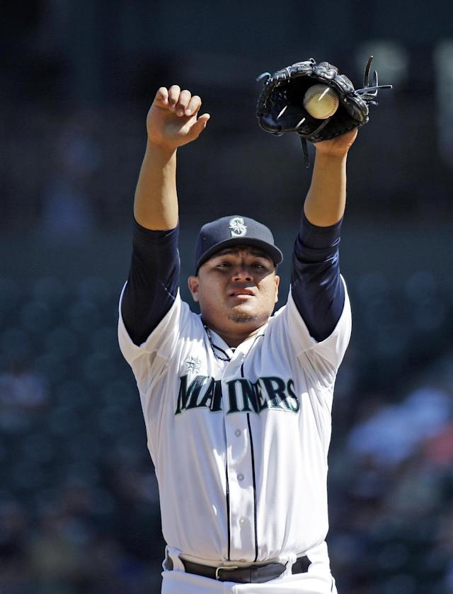 Seattle Mariners starting pitcher Erasmo Ramirez stretches before throwing to a Texas Rangers batter in the first inning of a baseball game Wednesday, Aug. 27, 2014, in Seattle. AP Photo/Elaine Thompson)
