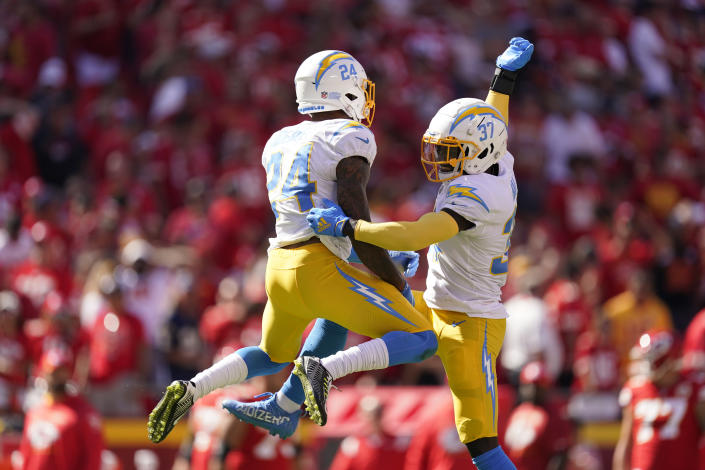 Los Angeles Chargers' Nasir Adderley (24) and Kemon Hall (37) celebrate following an NFL football game against the Kansas City Chiefs, Sunday, Sept. 26, 2021, in Kansas City, Mo. Los Angeles won 30-24. (AP Photo/Charlie Riedel)