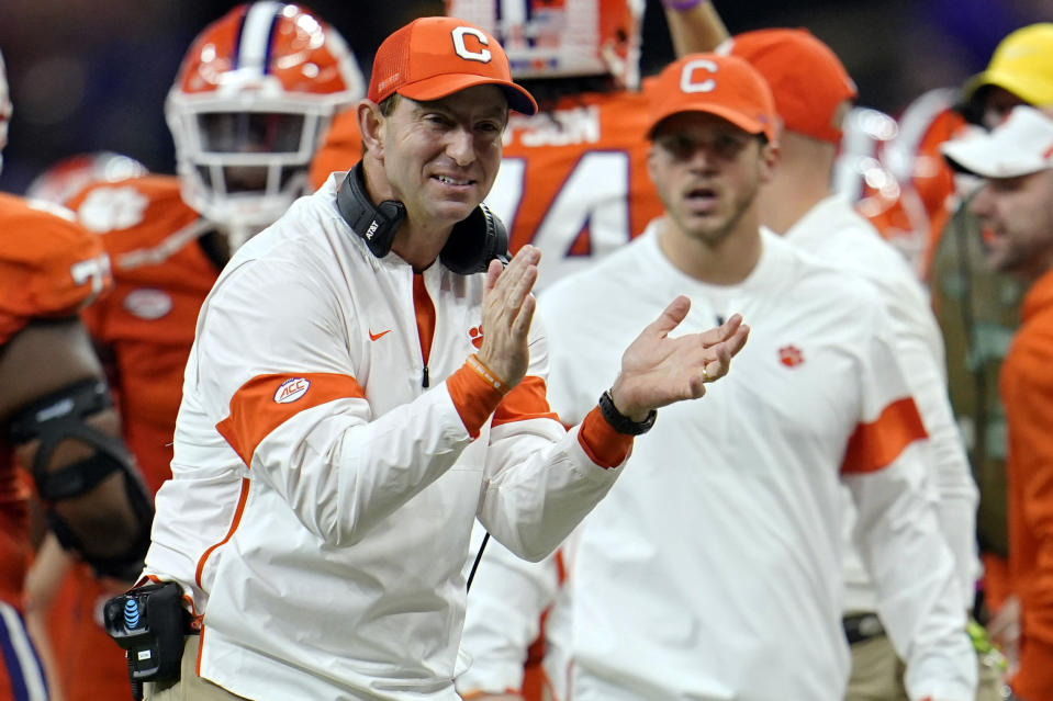 FILE - In this Jan. 13, 2020, file photo, Clemson head coach Dabo Swinney celebrates after his team scored during the second half of a NCAA College Football Playoff national championship game against LSU in New Orleans. Clemson is preseason No. 1 in The Associated Press Top 25, Monday, Aug. 24, 2020, a poll featuring nine Big Ten and Pac-12 teams that gives a glimpse at what's already been taken from an uncertain college football fall by the pandemic.  (AP Photo/David J. Phillip, File)