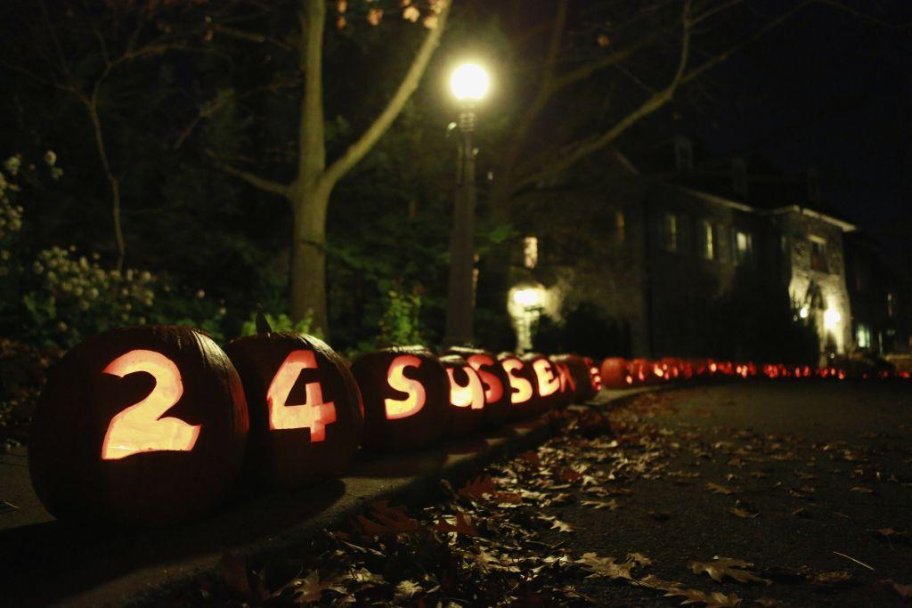 Carved pumpkins line the driveway of the official residence of Canada's Prime Minister Stephen Harper for Halloween in Ottawa.
