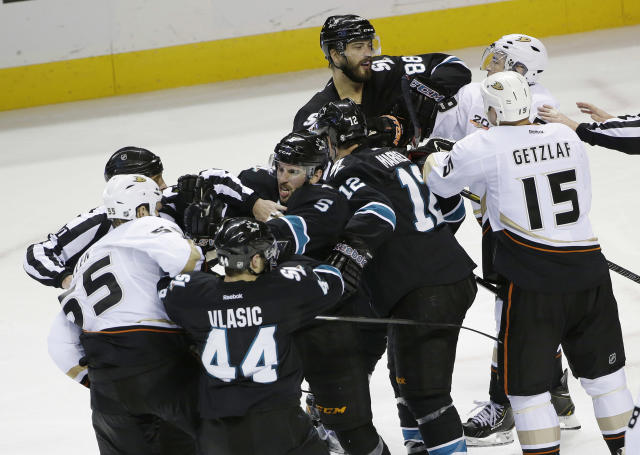 A fight breaks out between the San Jose Sharks and the Anaheim Ducks during the third period of an NHL hockey game on Thursday, March 20, 2014, in San Jose, Calif. San Jose won 3-2. (AP Photo/Marcio Jose Sanchez)
