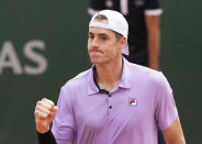 United States' John Isner celebrates winning a point against Serbia's Filip Krajinovic during their second round match on day four of the French Open tennis tournament at Roland Garros in Paris, France, Wednesday, June 2, 2021. (AP Photo/Michel Euler)