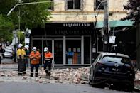 In the popular shopping area around the city's Chapel Street, masonry debris tumbled from buildings and littered the roads (AFP/William WEST)