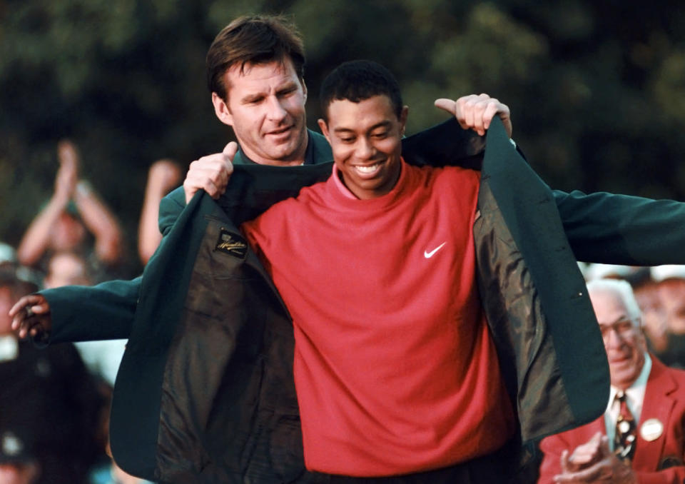 <p>Masters champion Tiger Woods receives his Green Jacket from last year's winner Nick Faldo, rear, at the Augusta National Golf Club in Augusta, Ga., Sunday, April 13, 1997. (AP Photo/ Dave Martin) </p>
