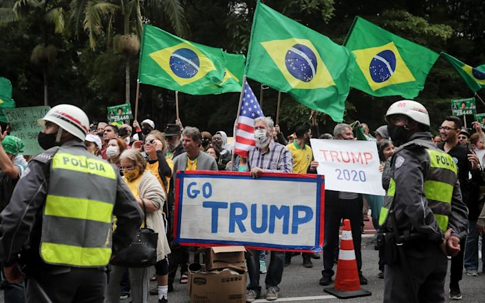 Supporters of Brazilian President Jair Bolsonaro voice their support for Donald Trump while attending a rally against the possibility of obligatory use of a vaccine against coronavirus - FERNANDO BIZERRA/EPA-EFE/Shutterstock /Shutterstock